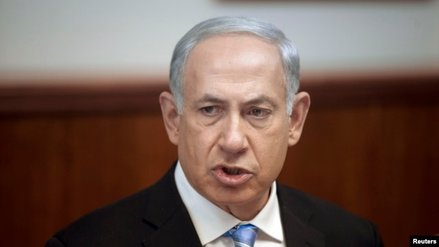 FILE - Israel's Prime Minister Benjamin Netanyahu attends the weekly cabinet meeting in Jerusalem. Oct. 27, 2013.