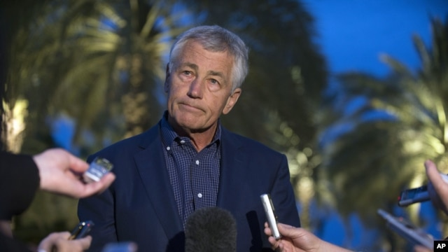 U.S. Secretary of Defense Chuck Hagel speaks with reporters after reading a statement on chemical weapon use in Syria during a press conference in Abu Dhabi, United Arab Emirates, April 25, 2013.