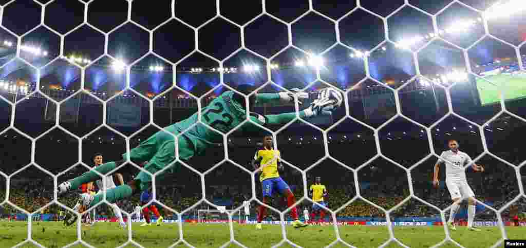 Ecuadorian goalkeeper Alexander Dominguez keeps the game close with this remarkable save against France at the Maracana stadium, in Rio de Janeiro, June 25, 2014.