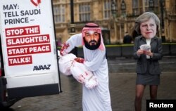 Activists stage a protest timed to coincide with the visit by Saudi Arabia's Crown Prince Mohammed bin Salman outside the Houses of Parliament in London, Britain, March 7, 2018.
