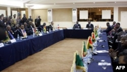 Delegates attend the Economic Community of West African States (ECOWAS) summit dedicated to the recent military coup in Mali, on April 2, 2012, in Dakar.