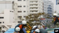Members of Tokyo Metropolitan Police Department take part in an earthquake disaster drill in Tokyo, September 1, 2011