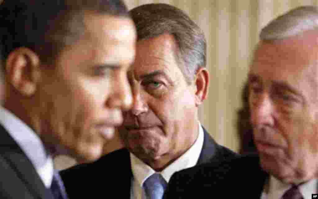 In this Feb., 2009 file photo, then-House Minority Leader John Boehner of Ohio, center, looks on as President Barack Obama talks to House Majority leader Steny Hoyer of Md. Republicans won control of the House in November's midterm elections, and Boehner