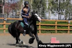 Mikhi Fearon, 17, rides Molly in a riding lesson at Ebony Horse Club, April 18, 2021.