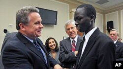 US Rep. Christopher Smith (l) greets Ker Deng, a young man who in recent years was freed from slavery in Sudan during which he was blinded, October 4, 2011