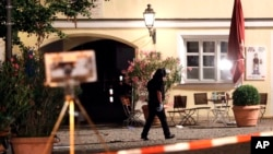 A special police officer examines the scene after an explosion occurred in Ansbach, Germany, Monday, July 25, 2016.