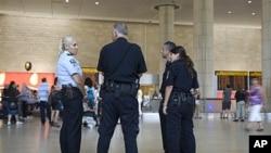 Israeli police officers stand guard at Ben Gurion international airport near Tel Aviv , July 7, 2011