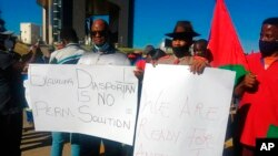 FILE - People protest in Windhoek, Namibia, May 28, 2021. Germany had just reached an agreement with Namibia to officially recognize as genocide the colonial-era killings of tens of thousands of people and commit to spending $1.3 billion, largely on development projects.