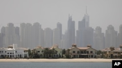 Jumeirah Palm Island luxury villas are seen by their private beaches in Dubai, United Arab Emirates, June 6, 2018. A new report released Tuesday, by the Washington-based Center for Advanced Defense Studies, relying on leaked property data from the city-state, described Dubai's real-estate market as a haven for money launderers, terror financiers and drug traffickers sanctioned by the U.S. in recent years.
