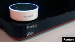 FILE - An Amazon Dot smart speaker is shown at the Dish Network booth during the 2017 CES in Las Vegas, Nevada Jan, 6, 2017.
