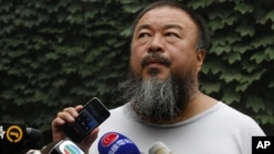 Chinese dissident artist Ai Weiwei listens as his lawyer announces over speakerphone the verdict of Ai's lawsuit against the tax authorities in Beijing, July 20, 2012.