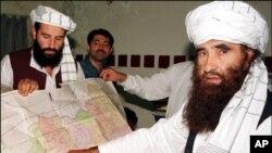 Sirajuddin Haqqani, far left, and Jalaluddin Haqqani, far right, then Taliban Army Supreme Commander, meet with reporters in Miram Shah, Waziristan on Aug. 22, 1998 (file photo).