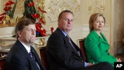 In this photo taken April 8, 2010, Michael McFaul, from left, the administration's top Russian expert, is seen with National Security Advisor Gen. Jim Jones, and Secretary of State Hillary Rodham Clinton, during a photo opportunity prior to a bilateral me
