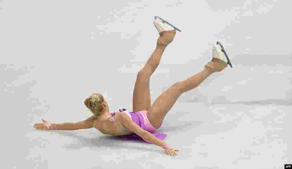 Lutricia Bock of Germany takes a fall during ladies short program at the European Figure Skating Championship in Bratislava, Slovakia.