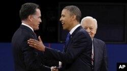 Митт Ромни и Барак Обама во время предвыборных дебатов