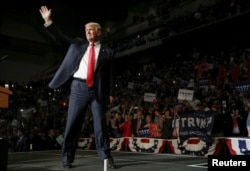 FILE - Republican U.S. presidential nominee Donald Trump arrives on stage at a campaign rally in Wilkes-Barre, Pennsylvania, Oct. 10, 2016.