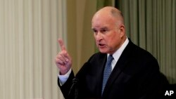 FILE - California Gov. Jerry Brown delivers his annual State of the State address before a joint session of the Legislature in Sacramento, Calif., Jan. 25, 2018.