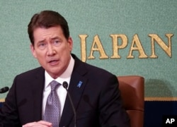 FILE - U.S. Ambassador to Japan William Hagerty speaks during a news conference at the Japan National Press Club in Tokyo, Nov. 17, 2017.