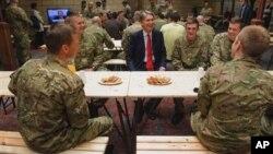 British Defense Secretary Philip Hammond during visit to temporary Army barracks, east London, July 20, 2012.