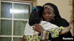 Mourners embrace each other as they pay their respects to the family of Bilikisu Yusuf in Kaduna, Nigeria, Sept. 26, 2015. Yusuf was one of the victims of a stampede during the hajj pilgrimage in Saudi Arabia's Mina.