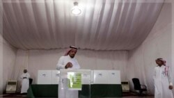 A Saudi man casts his ballot during municipal elections in Riyadh, Saudi Arabia, Thursday, Sept. 29, 2011. King Abdullah of Saudi Arabia granted women on Sept. 25, 2011, the right to vote and run in municipal elections from 2015 onwards, a historic first