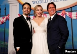"""Cast member Lin Manuel-Miranda, Emily Blunt and director Rob Marshall pose at the world premiere of Disney's movie """"Mary Poppins Returns"""" in Los Angeles, Nov. 29, 2018."""