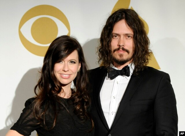 In this Nov. 30, 2011 file photo, Joy Williams, left, and John Paul White of the band The Civil Wars pose backstage at the Grammy Nominations Concert in Los Angeles.