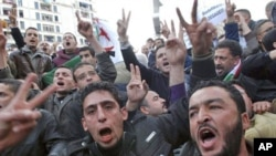 Algerian protesters chant slogans during a demonstration in Algiers, Algeria, February 12, 2011