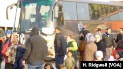 New arrivals are transferred by bus to other refugee camps in Athens, Greece, March 17, 2016.