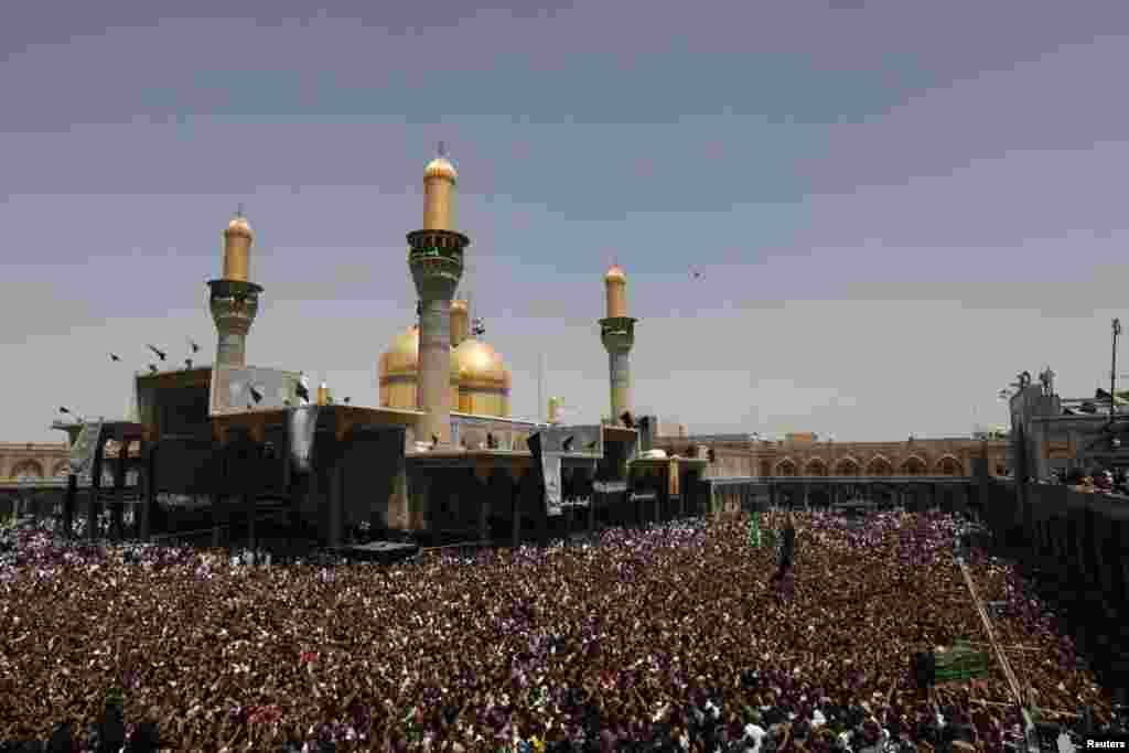 Shi'ite pilgrims gather at Imam Moussa al-Kadhim shrine to mark his death anniversary in Baghdad's Kadhimiya district.