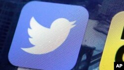 FILE - A Twitter app is seen on an iPhone screen, Oct. 18, 2013.