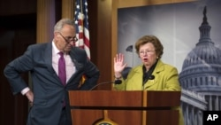 FILE - Sen. Barbara Mikulski, who supports the Iran nuclear deal, and Sen. Charles Schumer, who opposes it, are seen during a news conference on Capitol Hill in Washington, June 9, 2015.