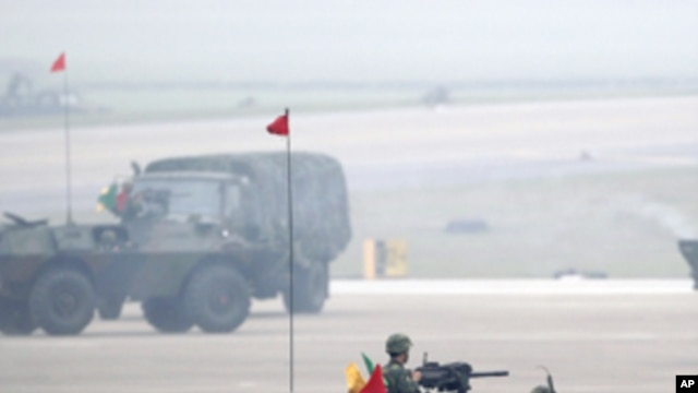 Soldiers in armored vehicles take part in an anti-airborne drill as part of the annual Han Kuang military exercise at the Chingchuankang Air Force Base in Taichung, central Taiwan, April 14, 2011.