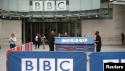 BBC workers place barriers near to the main entrance of the BBC headquarters and studios in Portland Place, London, Britain.