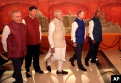 FILE - Leaders of BRICS nations, from left, Brazilian President Michel Temer, Chinese President Xi Jinping, Indian Prime Minister Narendra Modi, Russian President Vladimir Putin and South African President Jacob Zuma are seen prior to dinner hosted by Modi in Goa, India, Oct. 15, 2016. Of the five nations, three are not sending their heads of governments to the upcoming OBOR program, according to the list released by the Chinese foreign minister.