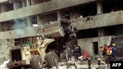 photo taken on August 8, 1998 shows police workers removing the remains of the car-bomb used to destroy the US embassy in Nairobi, that killed 280 Kenyans and 12 Americans. Kenya and Tanzania on August 7, 2018 will commemorate the 20th anniversary of the attacks against the US embassies in Nairobi and Dar es Salaam, which marked the emergency of terrorist group al-Qaeda on the international scene and changed the relationship of people to their personal security. In mid-morning of August 7, 1998, an important explosion devastated the US embassy in central Nairobi. The attack was followed a few minutes later by another blast in Dar es Salaam. Both attacks killed 224 people and injured 5,000, mostly Africans.