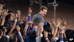 Facebook's CEO Mark Zuckerberg interacts with technology students in a town hall-style meeting in New Delhi, India, Oct. 28, 2015.