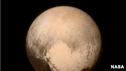 NASA image of Pluto showing heart shaped Tombaugh Regio. (NASA/Johns Hopkins University)