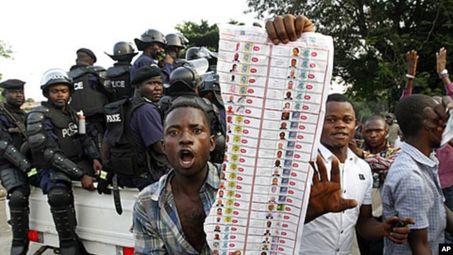 Supporters of oppositions candidate Etienne Tshisekedi parade what they claim are badly printed photocopies of election ballots they say they found in the Bandal commune in Kinshasa, Democratic Republic of Congo, November 28, 2011.
