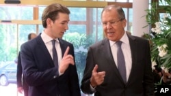 Austrian Foreign Minister Sebastian Kurz talks with Russian Foreign Minister Sergey Lavrov, right, before a informal ministerial meeting of the Organization for Security and Cooperation in Europe, OSCE, in Mauerbach near Vienna, Austria, July 11, 2017