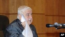 敘利亞外長穆阿利姆星期一在大馬士革的一個記者會上