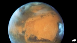 This May 12, 2016 image provided by NASA shows the planet Mars. (NASA/ESA/Hubble Heritage Team - STScI/AURA, J. Bell - ASU, M. Wolff - Space Science Institute via AP)