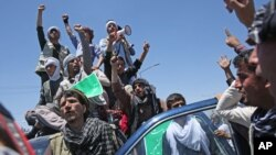 Supporters of presidential candidate Abdullah Abdullah shouts slogans during a protest in Kabul, Afghanistan, Saturday, June 21, 2014.