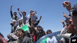 Supporters of presidential candidate Abdullah Abdullah shout slogans during a protest in Kabul, Afghanistan, Saturday, June 21, 2014.