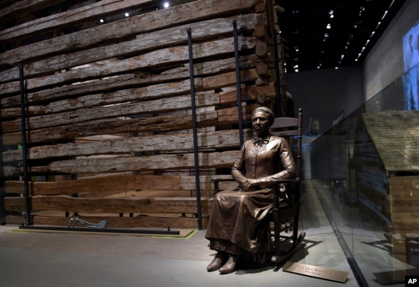FILE - A statue of pioneer Clara Brown, who was born a slave in Virginia around 1800, is on display at the National Museum of African American History and Culture in Washington, Sept. 14, 2016.