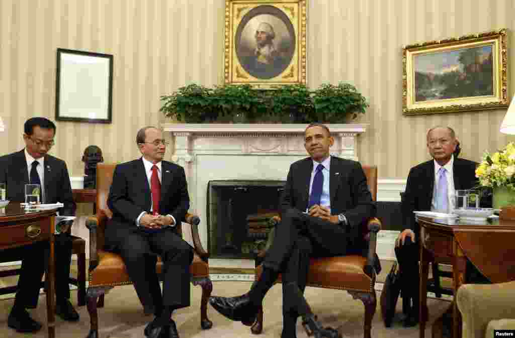 President Barack Obama sits with Burma's President Thein Sein in the Oval Office at the White House, Washington, May 20, 2013.