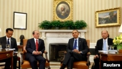 U.S. President Barack Obama sits with Burma's President Thein Sein in the Oval Office at the White House, Washington, May 20, 2013.