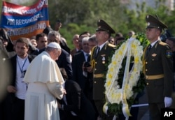 FILE - Pope Francis, left, attends a ceremony at a memorial to Armenians killed by Ottoman Turks during World War I, in Yerevan, Armenia, June 25, 2016.