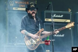 FILE - Lemmy Kilmister of Motörhead performs at THE Glastonbury Music Festival at Worthy Farm, Glastonbury, England, June 26, 2015.