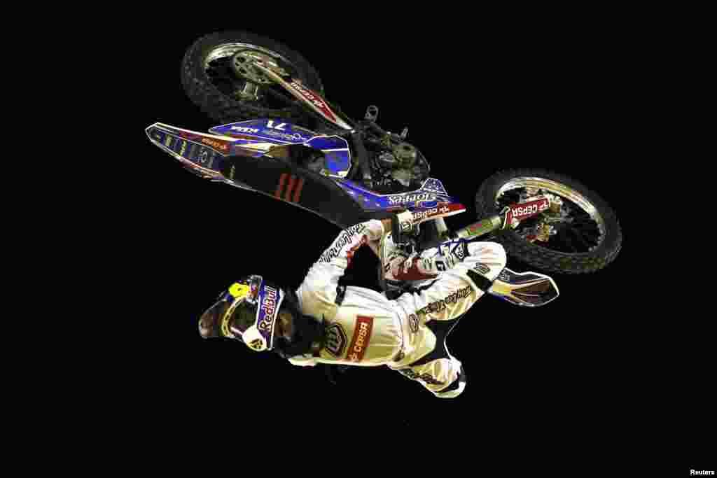 Spanish rider Dani Torres performs a jump during the Burn Freestyle Malaga motocross show at the Malagueta bullring in Malaga, southern Spain.